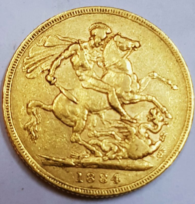 Золотая монета конь